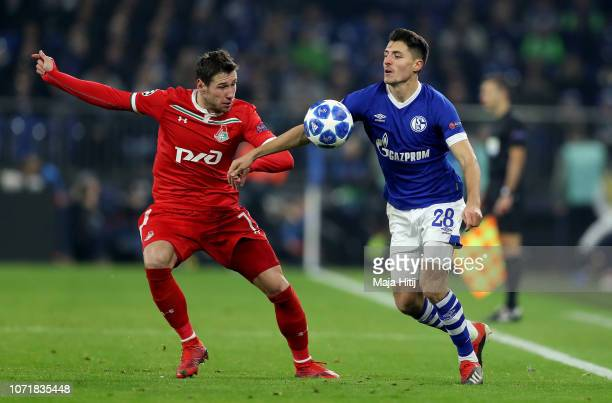 Alessandro Schoepf of Schalke challenges Grzegorz Krychowiak of Moscow during the UEFA Champions League Group D match between FC Schalke 04 and FC...