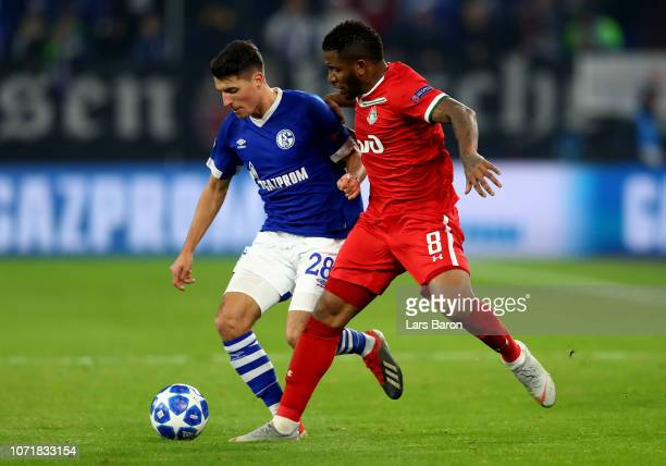 Alessandro Schoepf of Schalke challenges Jefferson Farfan of Moscow during the UEFA Champions League Group D match between FC Schalke 04 and FC...