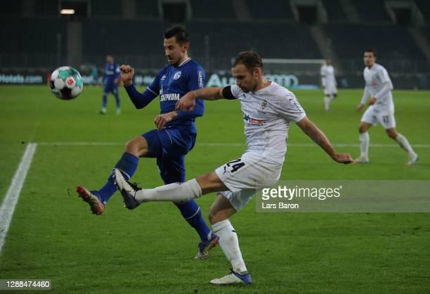 Alessandro Schoepf of Schalke challenges Tony Jantschke of Moenchengladbach during the Bundesliga match between Borussia Moenchengladbach and FC...