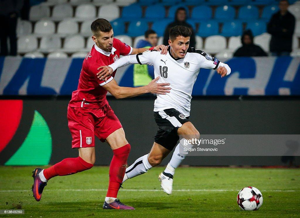 Alessandro Schopf (R) of Austria in action against Matija Nastasic (L) of Serbia during the FIFA 2018 World Cup Qualifier between Serbia and Austria at stadium Rajko Mitic on October 9, 2016 in Belgrade, .
