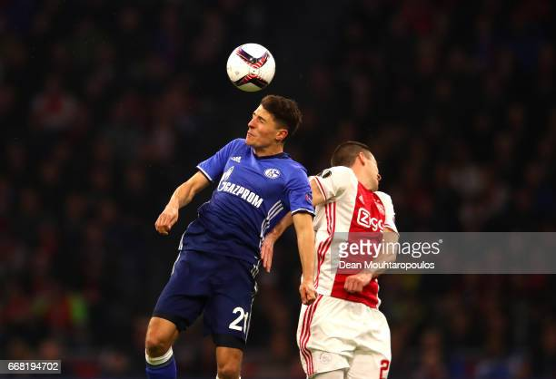 Alessandro Schopf of FC Schalke 04 and Nick Viergever of Ajax in action during the UEFA Europa League quarter final first leg match between Ajax...