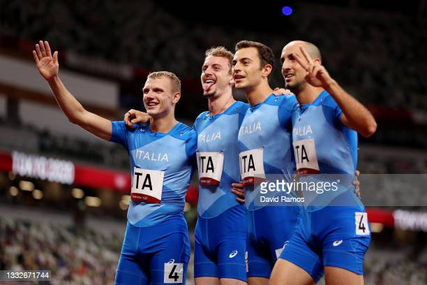 Alessandro Sibilio, Vladimir Aceti, Edoardo Scotti and Davide Re of Team Italy pose for a photo after the Men's 4 x 400m Relay on day fourteen of the...