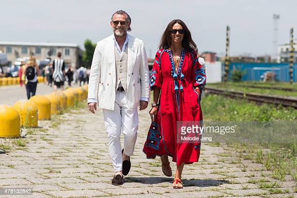 Alessandro Squarzi and Vivana Volpicella exit the Gucci show poses on June 22 2015 in Milan Italy