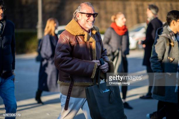 Alessandro Squarzi is seen wearing brown shearling jacket white pants during the 95th Pitti Uomo at Fortezza Da Basso on January 10 2019 in Florence...