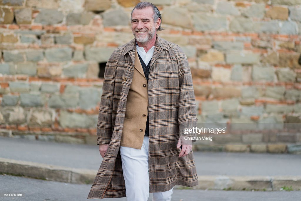 Alessandro Squarzi is wearing a brown checked coat, white pant on January 10, 2017 in Florence, Italy.