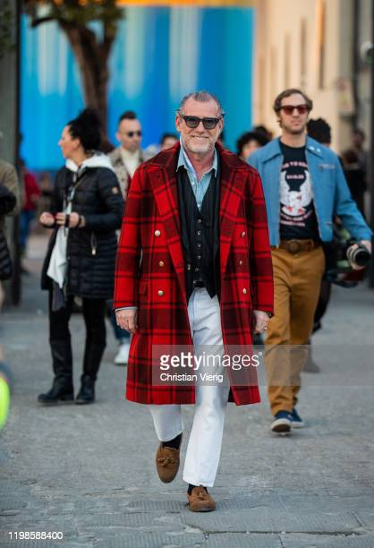 Alessandro Squarzi seen wearing red checkered coat white pants during Pitti Uomo 97 at Fortezza Da Basso on January 09 2020 in Florence Italy