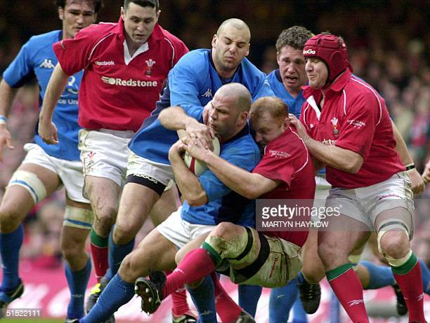 Alessandro Trocon of Italy is halted in a charge during the Wales v Italy match of the Lloyds TSB Six Nations Championship at the Millenium Stadium...