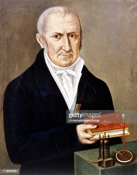 Alessandro Volta Italian physicist On table are two of his inventions the Voltaic pile on left and electrophorus an apparatus demonstrating...
