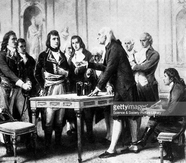 Alessandro Volta print showing Volta demonstrating his voltaic pile to Napoleon Italian physicist and inventor of the voltaic pile an early battery...