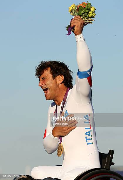 Alessandro Zanardi of Italy celebrates on the podium with his Gold medal after winning the Men's Individual H4 Time Trialon day 7 of the London 2012...