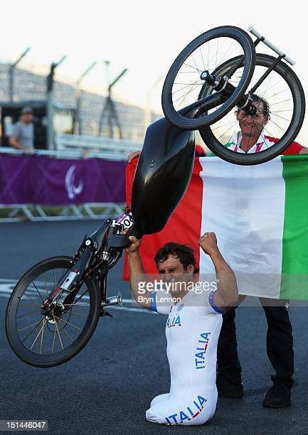 Alessandro Zanardi of Italy celebrates winning the Men's Individual H4 Road Race on day 9 of the London 2012 Paralympic Games at Brands Hatch on...