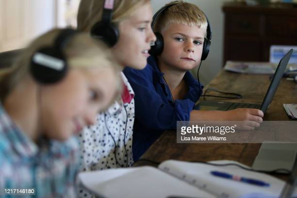 Alessia Bowman Sybella Bowman and Oliver Bowman do school work at their family home and cattle property on April 05, 2020 in Tarpoly Creek,...