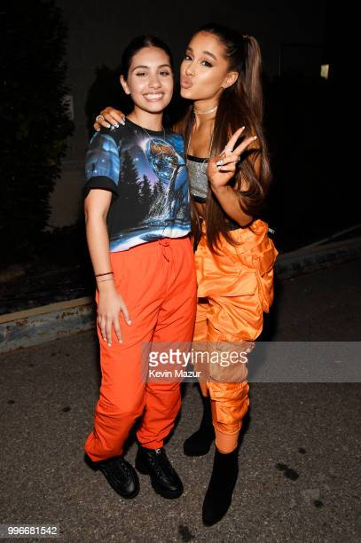 Alessia Cara and Ariana Grande pose backstage at the Amazon Music Unboxing Prime Day event on July 11 2018 in Brooklyn New York