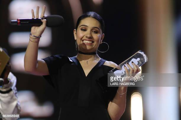 Alessia Cara celebrates winning Pop Album of the Year during the JUNO awards show at the Canadian Tire Centre in Ottawa Canada April 2 2017 / AFP...