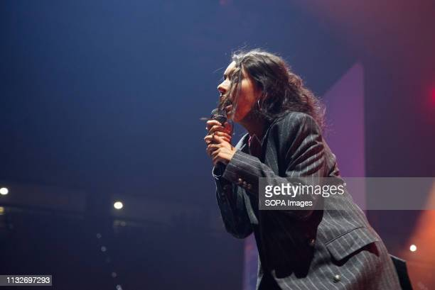 Alessia Cara performs on stage at Pala Alpitour in Turin.