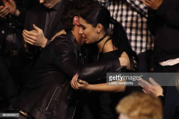 Alessia Cara who won Pop Album of the Year is given a hug from Shawn Mendes during the JUNO awards show at the Canadian Tire Centre in Ottawa Canada...