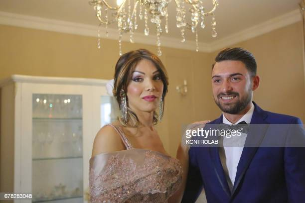 Alessia Cinquegrana Miss Italia Trans 2014 poses with her boyfriend Michele Picone in the living room of her apartment ready to go to the town hall...