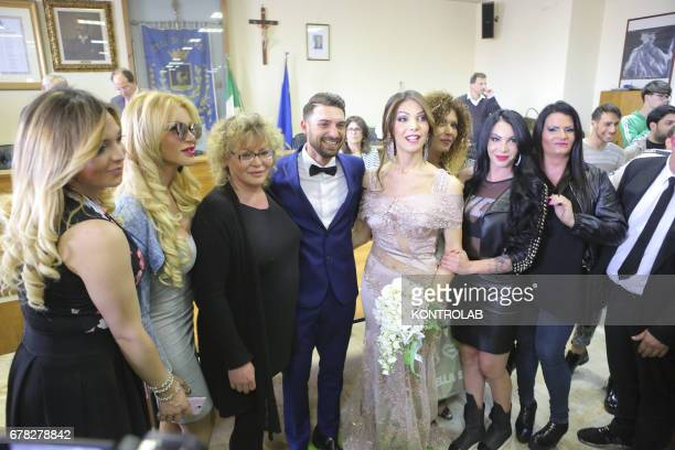 Alessia Cinquegrana Miss Trans 2014 posing with her husband Michele Picone and her transsexual friends and Vice President of the ATN association...