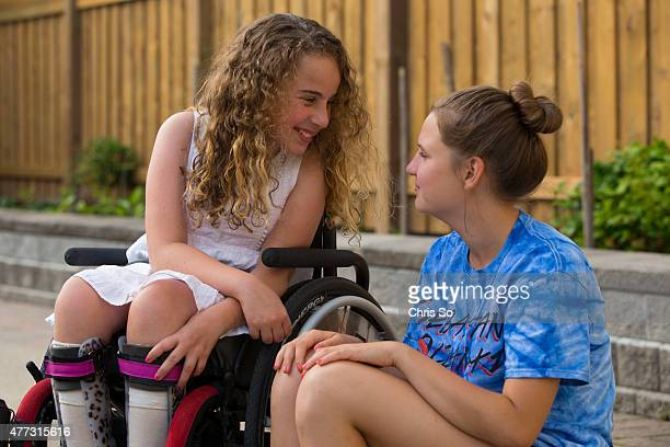 Alessia Commisso left and Weronika Rodowicz 13 share a joke in the Commisso family back yard Sonia Commisso the mother of Alessia 12 is frustrated...