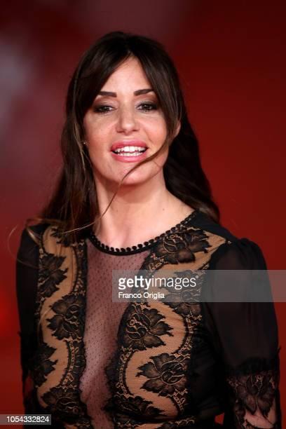 "Alessia Fabiani walks the red carpet ahead of the ""Notti Magiche"" screening during the 13th Rome Film Fest at Auditorium Parco Della Musica on..."