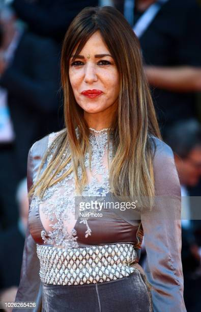 Alessia Fabiani walks the red carpet ahead of the 'The Sisters Brothers' screening during the 75th Venice Film Festival on September 2 2018 in Venice...