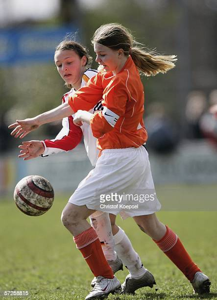 Alessia Kozian of Germany tackles Tessa Oudejans of the Netherlands during the Women's Under 15 International friendly match between Netherlands and...