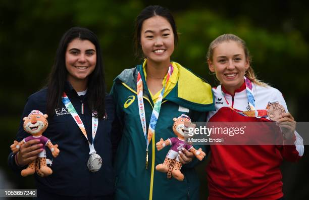 Alessia Nobilio of Italy Grace Kim of Australia and Emma Spitz of Austria pose with their medals after the Women's Individual Stroke Play Round 3...