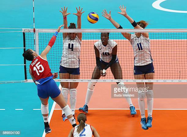 Alessia Orro and Cristina Chirichella of Italy block the ball against Daly Santana of Puerto Rico during the women's qualifying volleyball match...