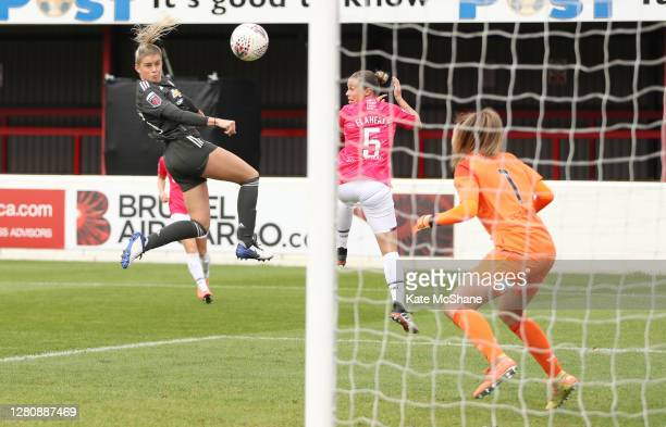 Alessia Russo of Manchester United scores her team's third goal past Mackenzie Arnold of West Ham United during the Barclays FA Women's Super League...