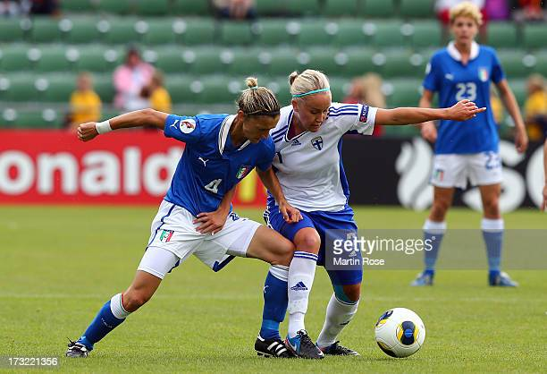 Alessia Tuttino of Italy battles for the ball with Annika Kukkonen of Finland during the UEFA Women's Euro 2013 group A match at Orjans Vall on July...