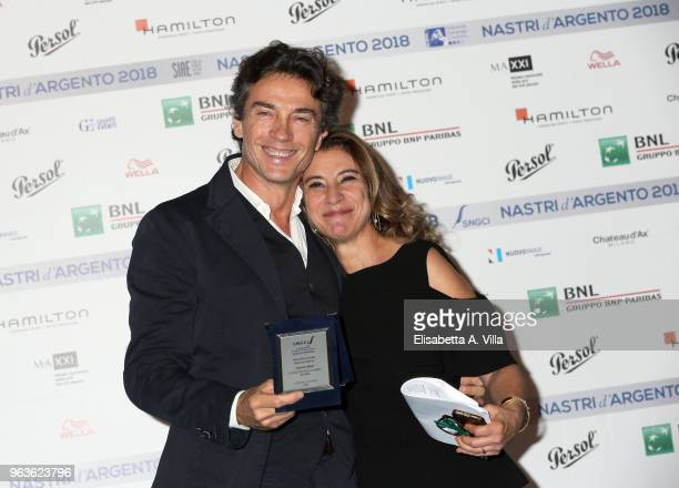 Alessio Boni and Giulia Martinez attend a photocall ahead of the Nastri D'Argento nominees presentation at Maxxi Museum on May 29 2018 in Rome Italy