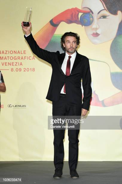 Alessio Boni poses with his award 2018 Kineo Awards during the 75th Venice Film Festival at Excelsior Hotel on September 2 2018 in Venice Italy