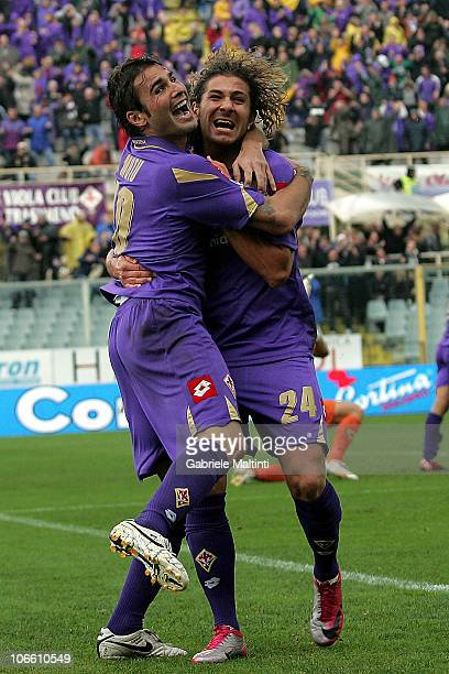 Alessio Cerci and Adrioan Mutu of ACF Fiorentina celebrate after scoring a goal during the Serie A match between Fiorentina and Chievo at Stadio...