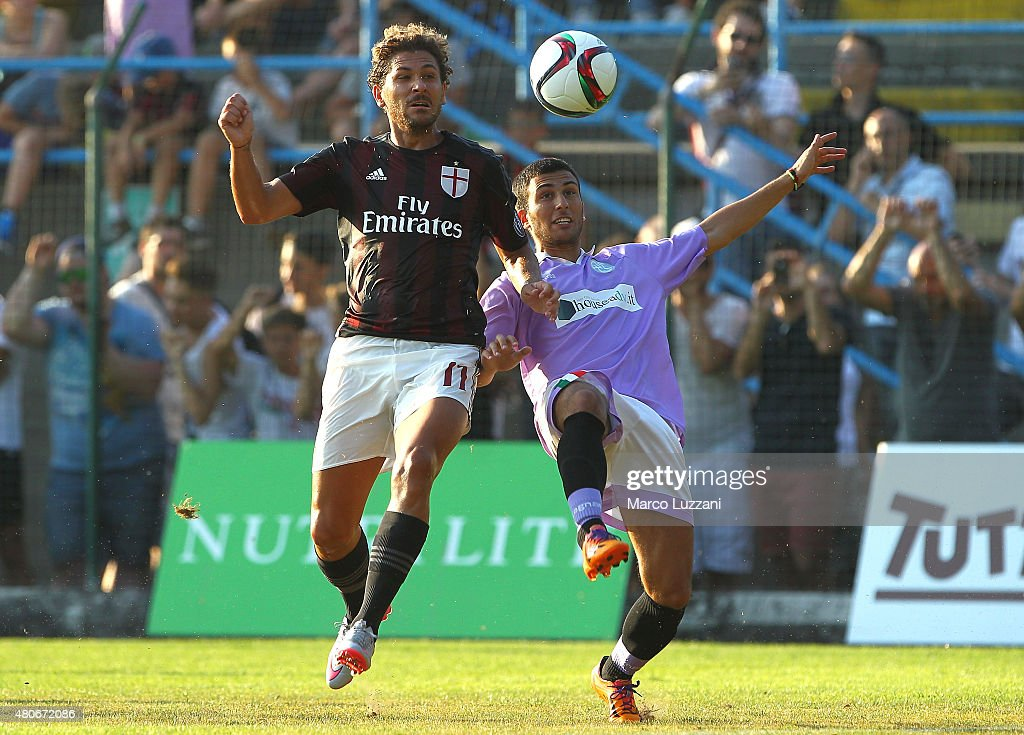 Alessio Cerci (L) of AC Milan competes for the ball during the preseason friendly match between AC Milan and Legnano on July 14, 2015 in Solbiate Arno, Italy.