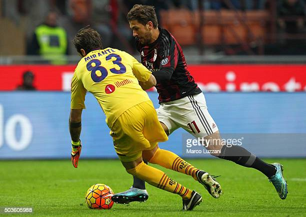 Alessio Cerci of AC Milan is challenged by Antonio Mirante of Bologna FC during the Serie A match between AC Milan and Bologna FC at Stadio Giuseppe...