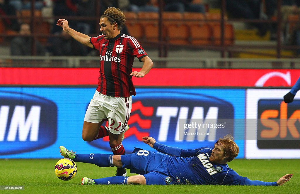 Alessio Cerci of AC Milan is challenged by Davide Biondini of US Sassuolo Calcio during the TIM Cup match between AC Milan and US Sassuolo Calcio at Stadio Giuseppe Meazza on January 13, 2015 in Milan, Italy.