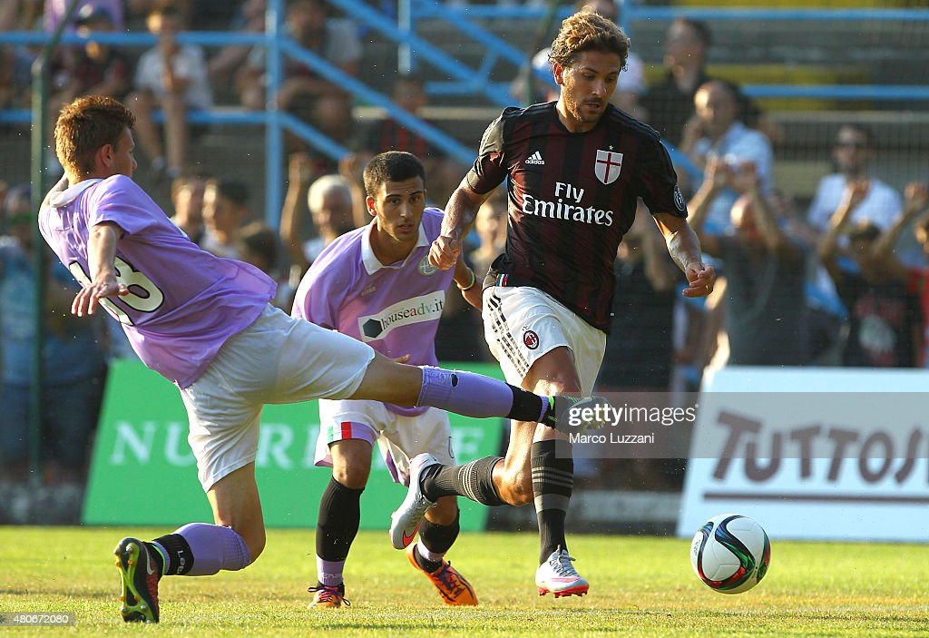 Alessio Cerci (R) of AC Milan is challenged during the preseason friendly match between AC Milan and Legnano on July 14, 2015 in Solbiate Arno, Italy.