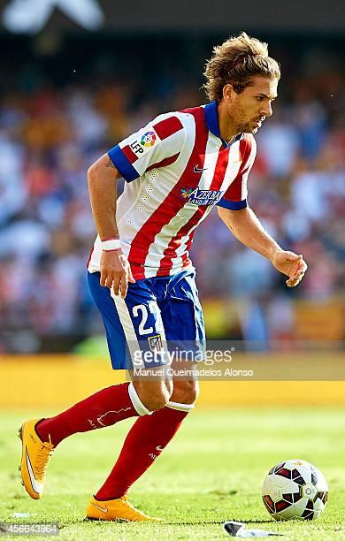 Alessio Cerci of Atletico de Madrid runs with the ball during the La Liga match between Valencia CF and Club Atletico de Madrid at Estadi de Mestalla...