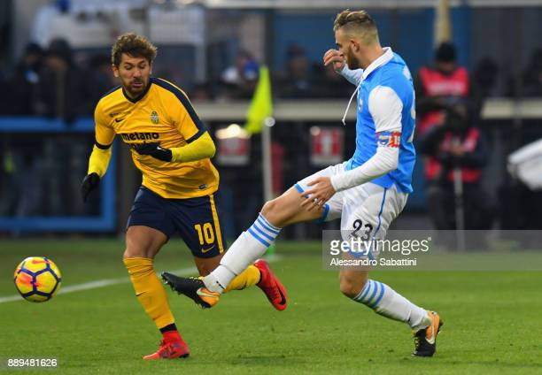 Alessio Cerci of Hellas Verona competes for the ball whit Francesco Vicari of Spal during the Serie A match between Spal and Hellas Verona FC at...