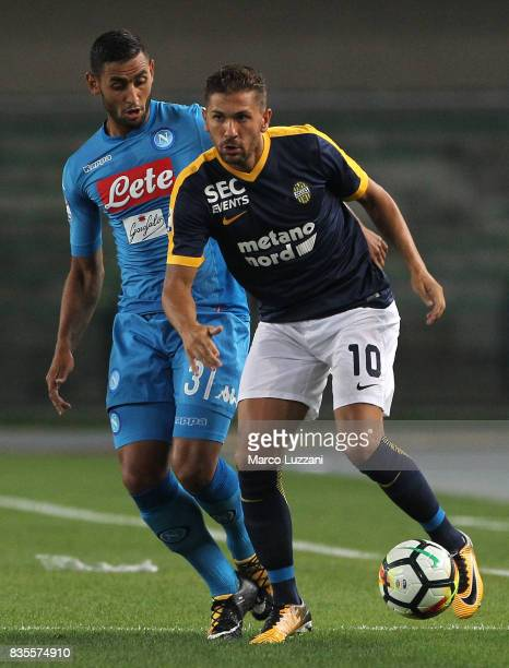 Alessio Cerci of Hellas Verona competes for the ball with Faouzi Ghoulam of SSC Napoli during the Serie A match between Hellas Verona and SSC Napoli...