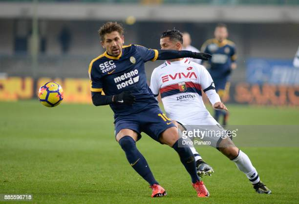 Alessio Cerci of Hellas Verona competes with Armando Izzo of Genoa CFC during the Serie A match between Hellas Verona FC and Genoa CFC at Stadio...