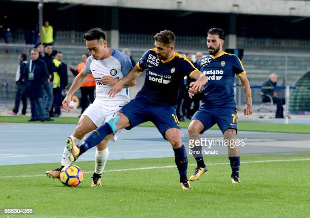 Alessio Cerci of Hellas Verona FC competes with Yuto Nagatomo of FC Internazionale during the Serie A match between Hellas Verona FC and FC...