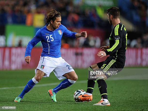 Alessio Cerci of Italy is tackled by Sergio Ramos of Spain during the international friendly match between Spain and Italy on March 5 2014 in Madrid...