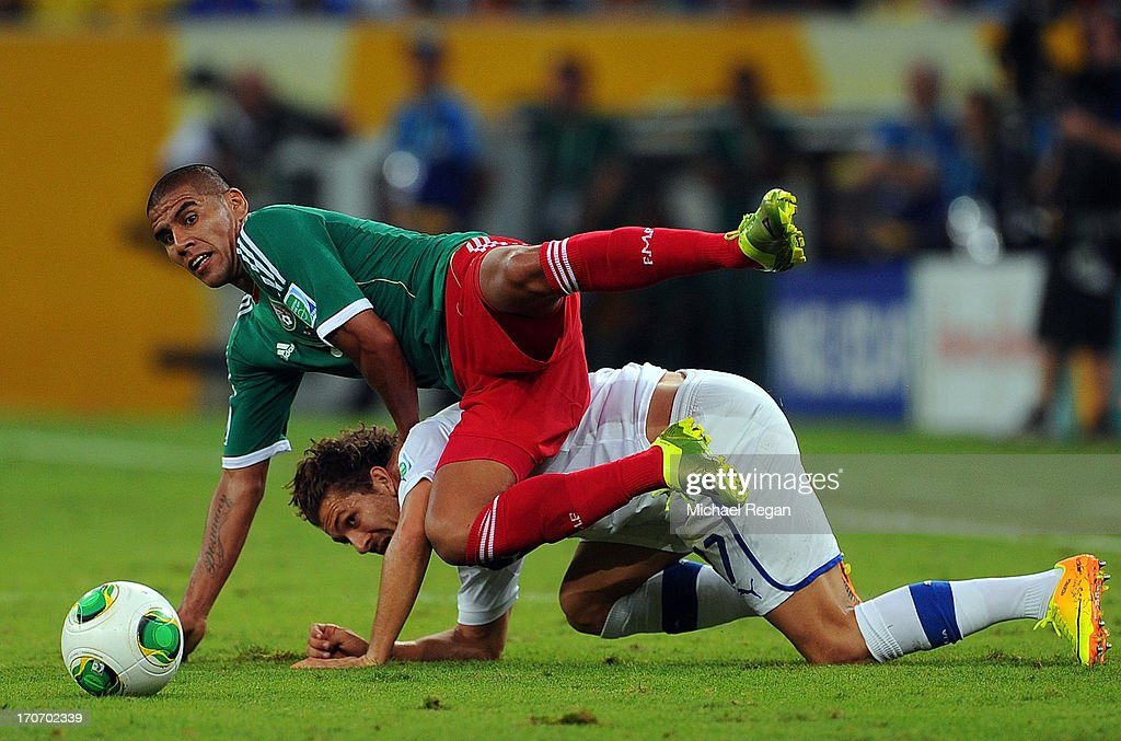Alessio Cerci of Italy tangles with Carlos Salcido of Mexico during the FIFA Confederations Cup Brazil 2013 Group A match between Mexico and Italy at the Maracana Stadium on June 16, 2013 in Rio de Janeiro, Brazil.