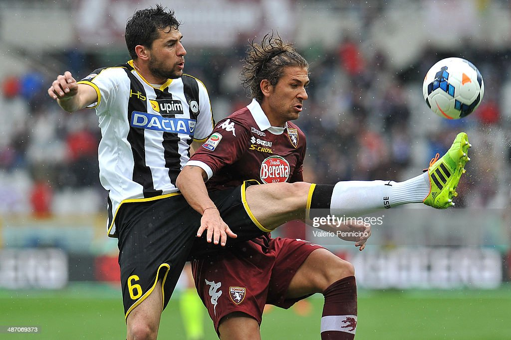 Alessio Cerci (R) of Torino FC is challenged by Igor Bubnjic of Udinese Calcio during the Serie A match between Torino FC and Udinese Calcio at Stadio Olimpico di Torino on April 27, 2014 in Turin, Italy.