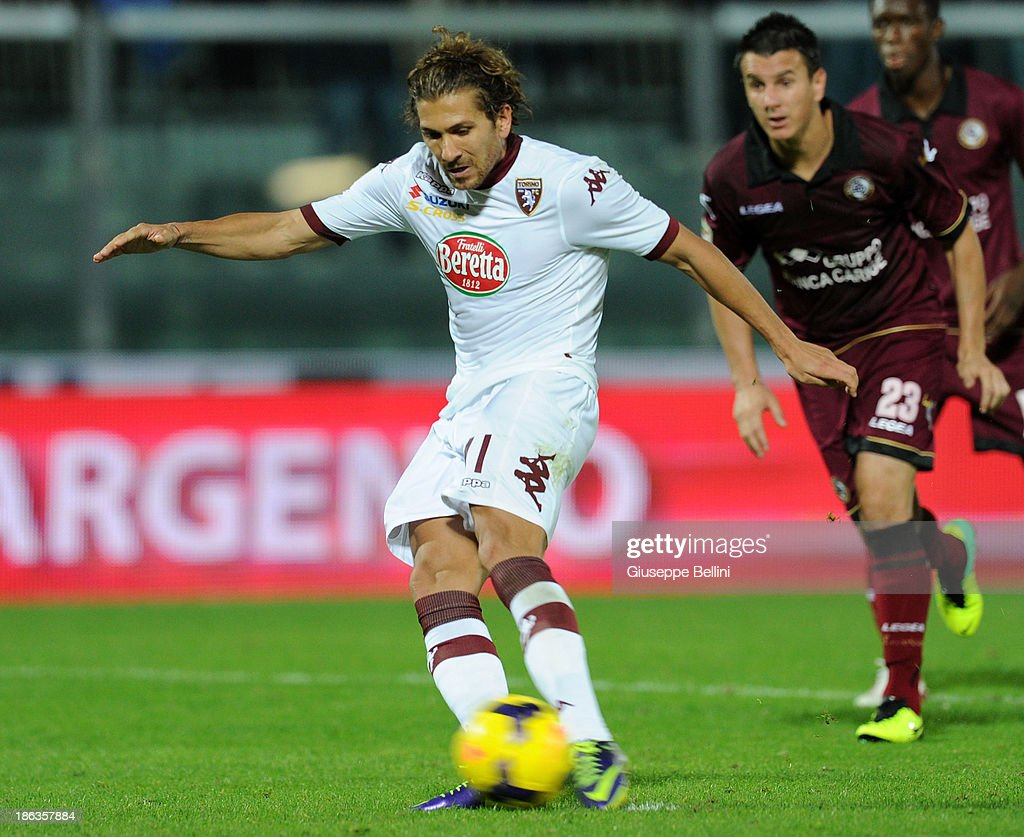 Alessio Cerci of Torino kicks the penalty and scores the goal 3-3 during the Serie A match between AS Livorno Calcio v Torino FC at Stadio Armando Picchi on October 30, 2013 in Livorno, Italy.