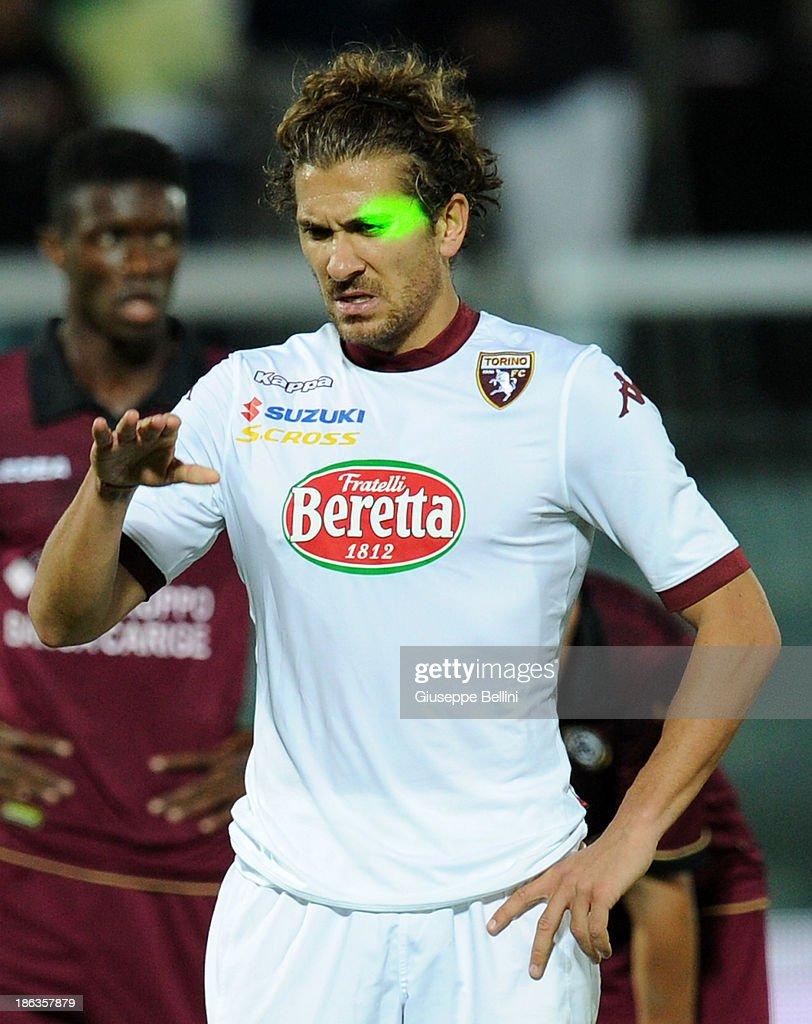 Alessio Cerci of Torino with a green laser on his face before kicking the penalty during the Serie A match between AS Livorno Calcio v Torino FC at Stadio Armando Picchi on October 30, 2013 in Livorno, Italy.