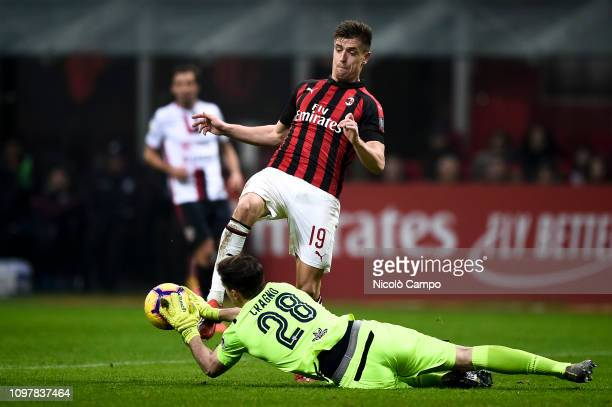 Alessio Cragno of Cagliari Calcio makes a save on Krzysztof Piatek of AC Milan during the Serie A football match between AC Milan and Cagliari Calcio...
