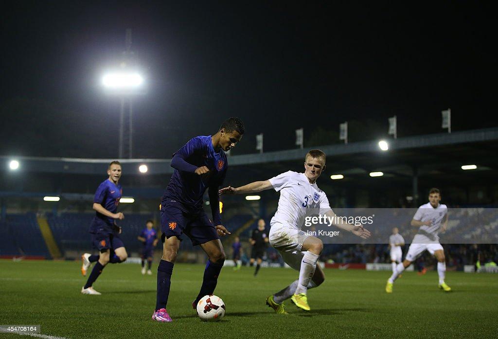 Alessio Da Cruz of Netherlands U18 controls the ball from Callum Connolly of England U18 during the U18 International Friendly match between England U18 and Netherlands U18 at JD Stadium on September 5, 2014 in Bury, England.