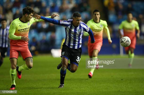Alessio Da Cruz of Sheffield Wednesday battles for possession with John Stones of Manchester City during the FA Cup Fifth Round match between...